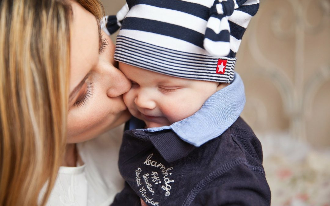 mother kissing her baby boy - Annie's Child Sleep Solutions